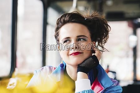 1980s retro styled woman sitting in