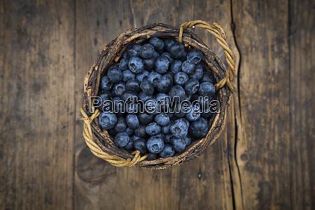 wicker basket with fresh blueberries