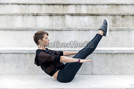 athletic woman during workout on stairs
