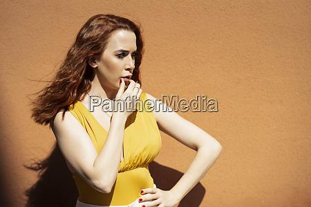 redheaded serious woman looking sideways
