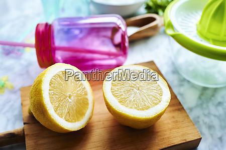 fresh halved lemon on cutting board