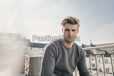 portrait of cool young man sitting