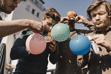 group of friends playing with balloons