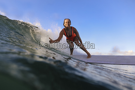 female surfer with thumb up