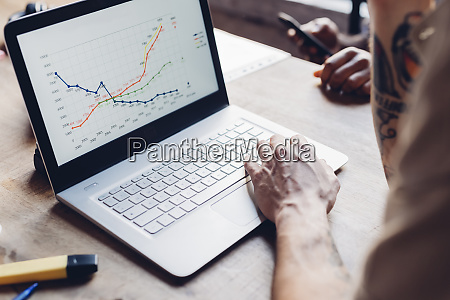 creative businessman analyzing line graph on