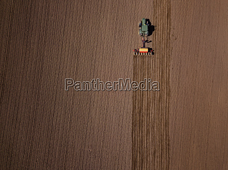 russia aerial view of tractor plowing