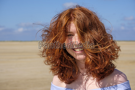 close up portrait of carefree redhead