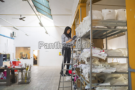 female employee on step ladder at