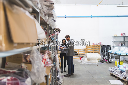 businessman and female employee talking in