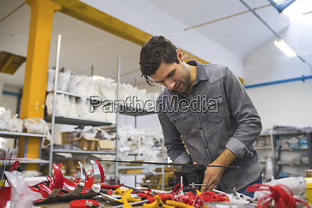 man working on fencing supplies on