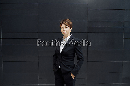 confident female professional with hands in