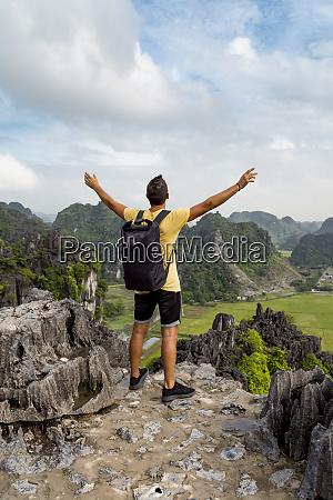 vietnam ninhbinhprovince ninhbinh male hiker standing
