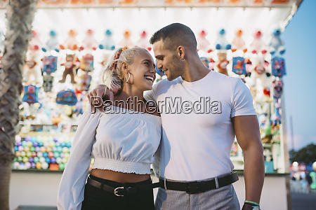 romantic boyfriend looking at happy woman