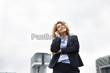 smiling female entrepreneur talking over smart