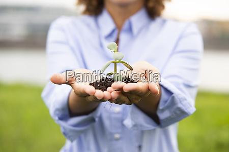 close up of female entrepreneur holding