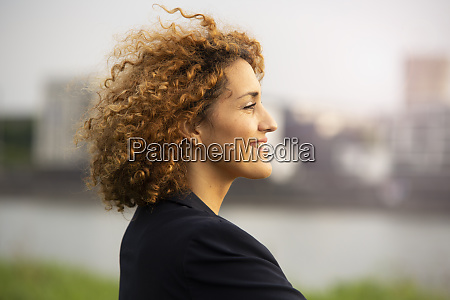 close up of smiling businesswoman with