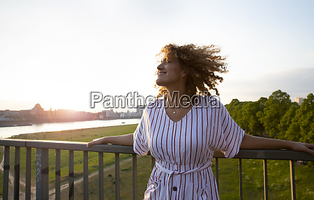 smiling mid adult woman with curly