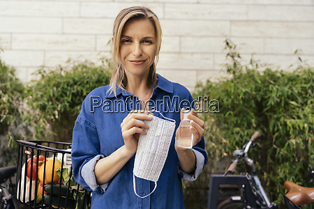 portrait of woman holding sanitizer and