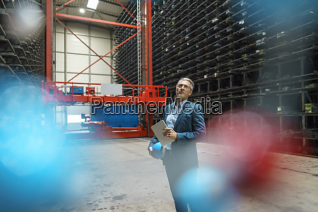 mature businessman holding tablet in a