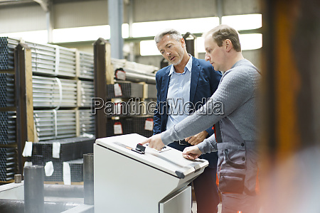 businessman talking to worker at a