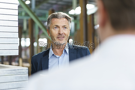 businessman talking to employee in a