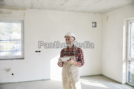 construction worker with tablet at construction
