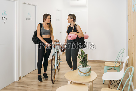 two sporty women arriving at health