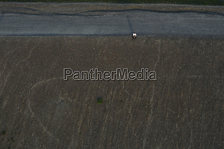 businessman sitting on hill drone view