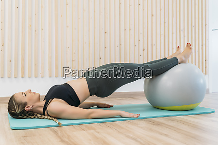 woman exercising with fitness ball at