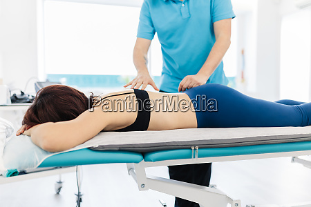 visually impaired therapist treating womans back