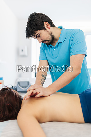 visually impaired male therapist massaging womans