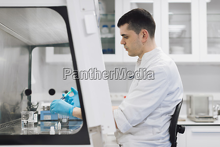 male healthcare worker doing research in
