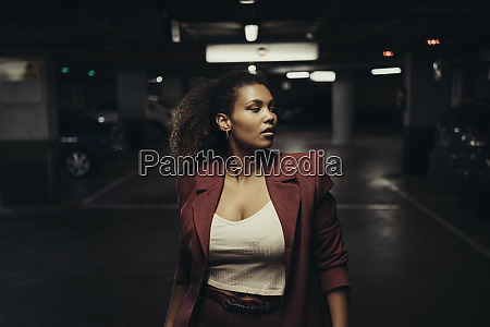 confident young businesswoman looking away while
