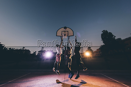 male african friends playing basketball in