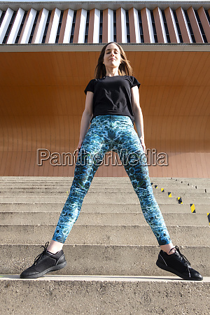 female fitness instructor standing on steps