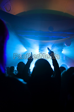 crowd cheering during electronic music festival