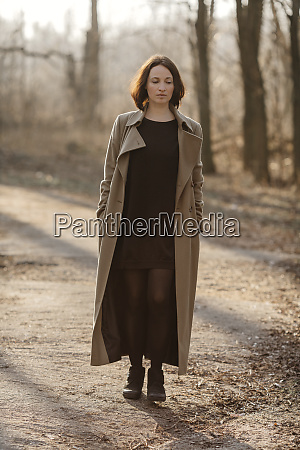 mature woman with hands in overcoat