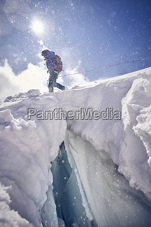 female mountaineer at crevasse against the