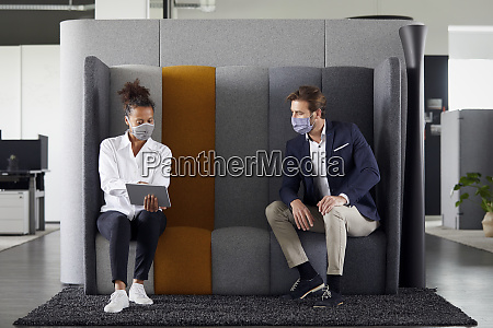 businesswoman consulting customer in office during