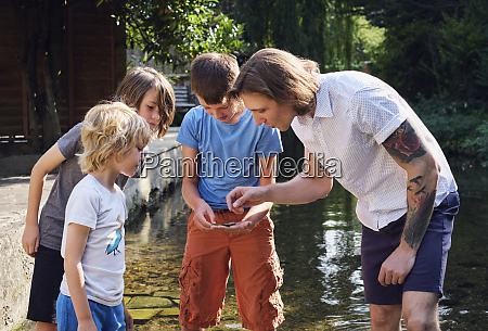 father and children looking at something