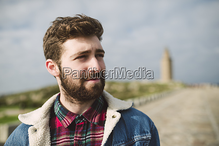 close up of thoughtful bearded man