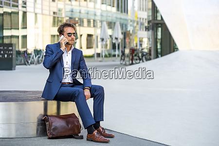 businessman on the phone outdoors frankfurt