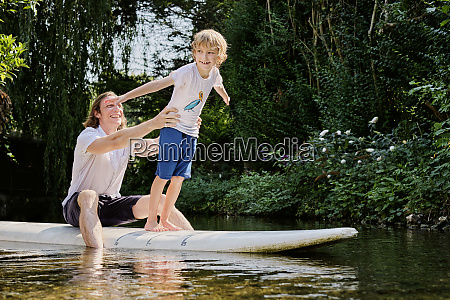 happy father holding boy standing on