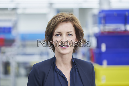 confident female manager in factory