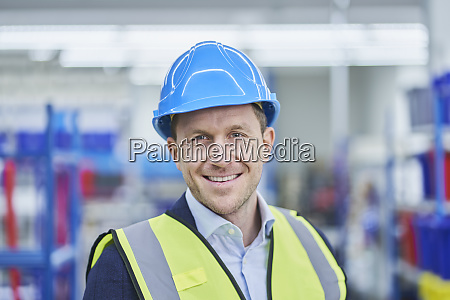 happy male supervisor wearing hardhat and