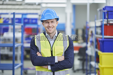 confident male supervisor in hardhat and