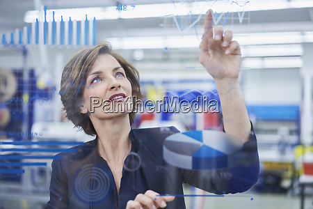 female manager touching line graph on