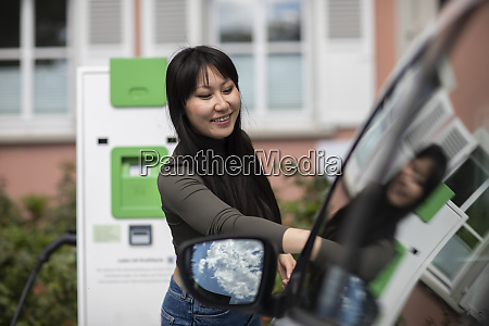 carsharing woman renting an electric car