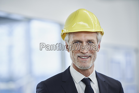 happy mature male manager wearing yellow