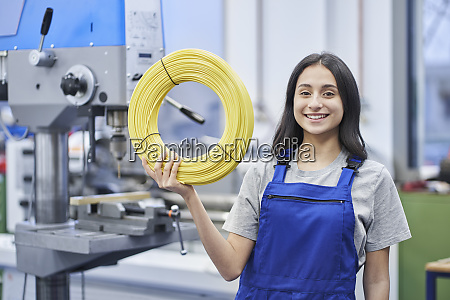 happy female worker holding rolled up